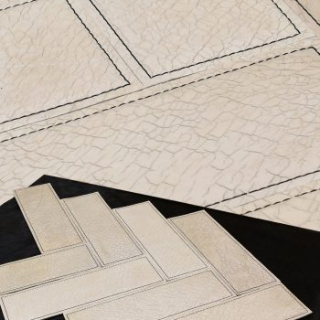 Stitched leather wall tiles by Keleen Leathers, Inc.